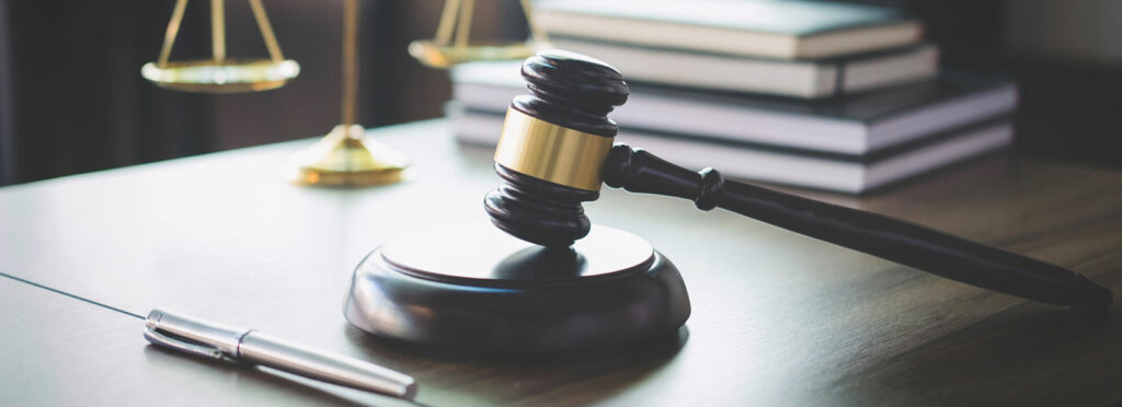 gavel on desk with justice scales