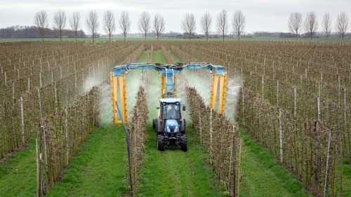 A machine spraying RoundUp on a field.