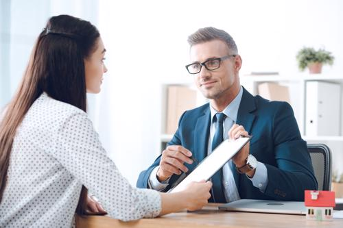 One of our Washington D.C. Roundup lawyers meeting with a female client reviewing a settlement.