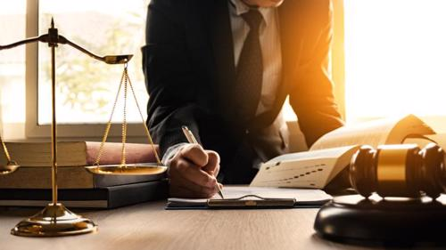 A lawyer working on paperwork for a PPI injury claim.