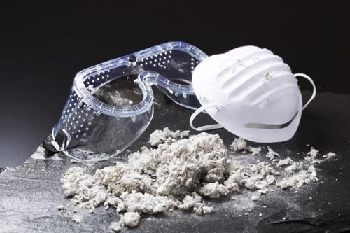 Safety goggles, a breathing mask, and pile of asbestos. Contact a lawyer to discuss your Phoenix mesothelioma lawsuit.