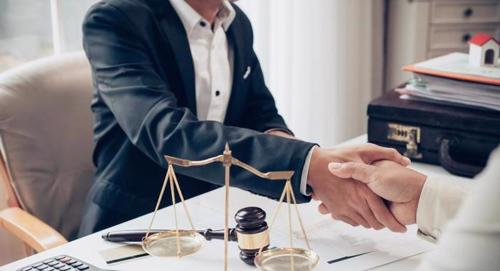 A man meeting with a lawyer at a mass tort law firm.