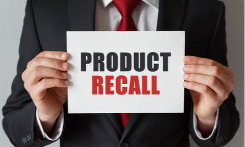 Businessman holding a card with text Product Recall