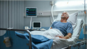 This is an image of an ill man laying in a hospital bed who filed a Medtronic HeartWare HVAD lawsuit